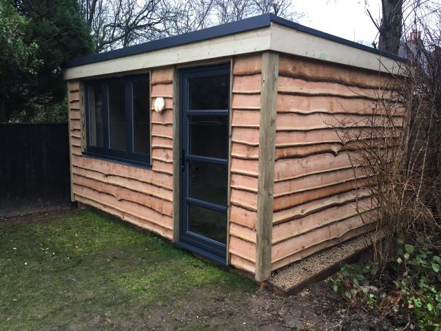 64/64 Larch Waney Edge Shed by CO2 Timber